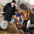 Family on a rabbit farm — Stock Photo #19226325