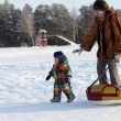 Mother and toddler on snow — Stock Photo #19412619