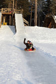 Family having fun on a sled — Stock Photo