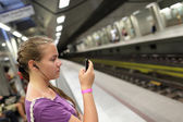 Girl waiting train — Stock Photo