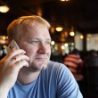 Man calling from cafe — Stock Photo
