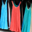 Dresses at outdoor market — Stock Photo #19577353