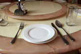 Round dining table — Stock Photo