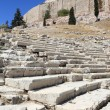 Seats in theatre of Dionysus and Acropolis — Stock Photo