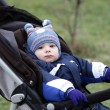 Stock Photo: Pensive toddler in stroller