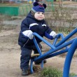 Stock Photo: Toddler holding handle of seesaw