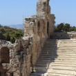 Stock Photo: Wall and seats of Odeon of Herodes Atticus