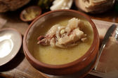 Broth with meat for Khash in armenian restaurant — Stock Photo