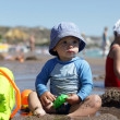 Baby playing on a beach — Stock Photo