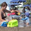 Foto Stock: Mother with boy on beach