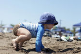 Toddler crawling on a beach — Stock Photo