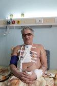 Senior man with white bandage on chest — Stock Photo