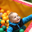 Toddler in box of balls — Stock Photo