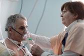 Doctor setting oxygen mask — Stock Photo