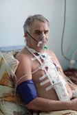 Senior man with oxygen mask — Stock Photo