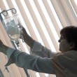 Stock Photo: Nurse installing dropper