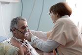 Nurse fixing oxygen mask — Stock Photo