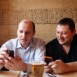 Two friends using mobile phones — Stock Photo #23053376