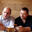Two friends with mobile phones — Stock Photo #23053390