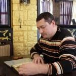 Man with menu — Stock Photo #23074206