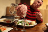 Man with decanter of vodka — Stock Photo
