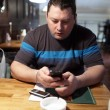 Man with phone in a pub — Stock Photo