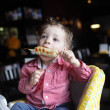 Child eating kebab - Stock Photo