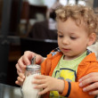 Stock Photo: Toddler holding sugar bowl