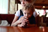 Toddler drinking cherry juice — Stock Photo