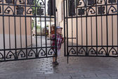 Boy closes the door — Stock Photo