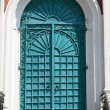 Green door of exaltation of the Cross cathedral — Stock Photo