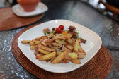 Fried potatoes with mushrooms — Stock Photo