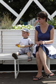 Mother with toddler resting on bench — Stock Photo