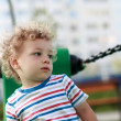 Thinking child at playground — Stock Photo #30402147