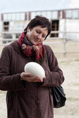 Woman holding ostrich egg — Stock Photo