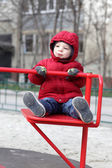 Boy at playground in autumn — Stock Photo