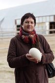 Woman with ostrich egg — Stock Photo