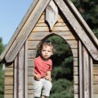 Boy at wooden house — Stock Photo