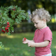 Curly child at garden — Stock Photo