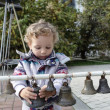 Stock Photo: Child with bells