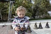 Criança com sinos — Fotografia Stock
