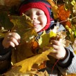 Toddler is lying on leaves — Stock Photo