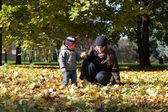 Mother with her son at park — Stock Photo