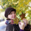Woman at autumn park — Stock Photo