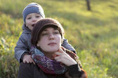 Mother with son on the grass — Stock Photo