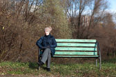 Woman resting on bench — Stock Photo
