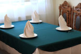 Table setting for four persons — Stock Photo