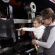 Child touching locomotive — Stock Photo