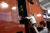 Child looking at locomotive cab — Stock Photo