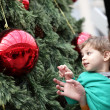 Child with mother at christmas tree — Foto Stock